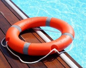 Red lifebuoy ring by the pool.